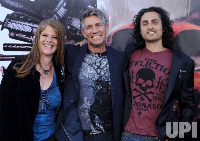 """Eric Roberts arrives with his wife Eliza Roberts and stepson Keaton Simmons at """"The Expendables"""" premiere in Los Angeles"""