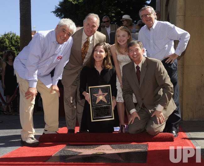 Richard Donner and Lauren Shuler Donner received stars on the Hollywood Walk of Fame