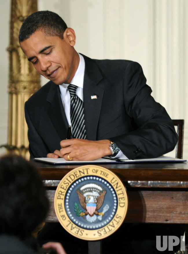 President Obama signs executive orders on fuel efficiency and vehicle emissions in Washington