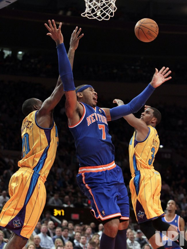 New Orleans Hornets plays defense against the New York Knicks Carmelo Anthony at Madison Square Garden in New York
