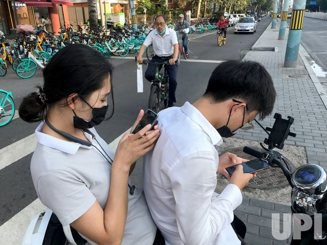 Chinese Use Their Smartphones in Beijing, China
