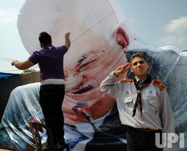 An effigy of Palestinian President Mahmoud Abbas deflates at the Agriculture Festival in Qalqilya, West Bank