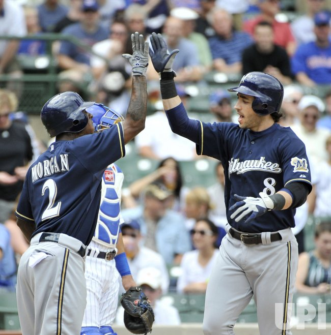 Brewers Morgan high-five Braun after homer against Cubs in Chicago