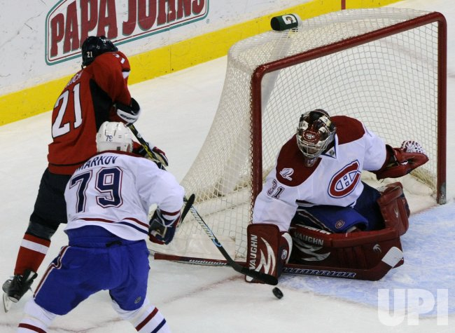 Canadiens Price blocks shot from Capitals Laich in Washington
