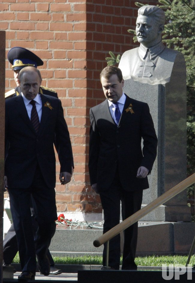 Russian President Medvedev and Prime Minister Putin attend a military parade