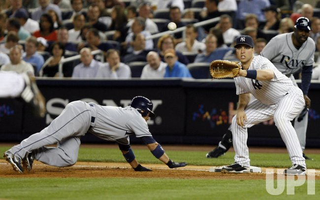 New York Yankees Mark Teixeira tries to pick off Tampa Bay Rays Akinori Iwamura at Yankee Stadium in New York