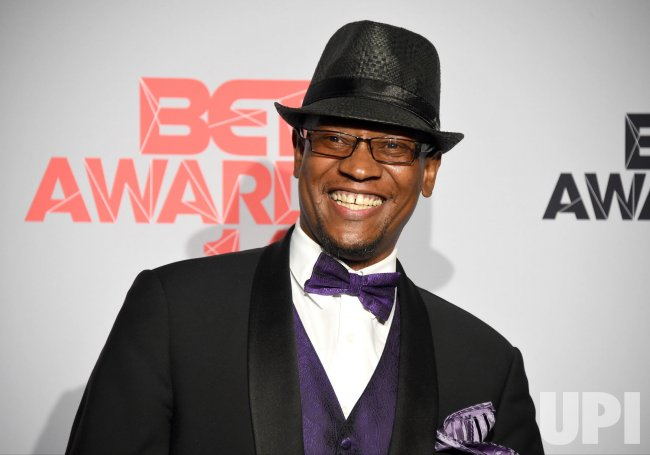 Marcus Duke wins an award at the BET Awards in Los Angeles