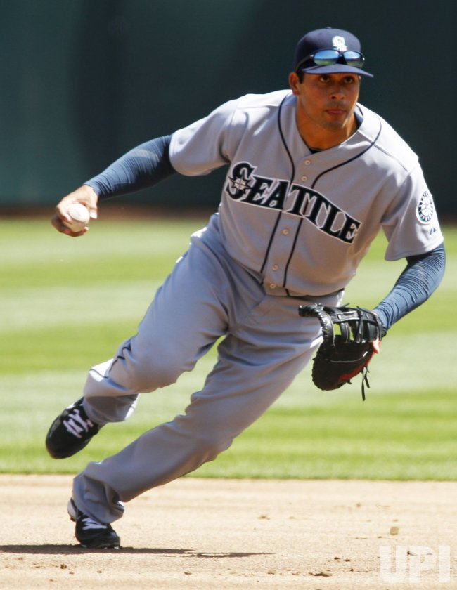 Seattle Mariners Matt Tuiasosopo fields a grounder against the Oakland A's
