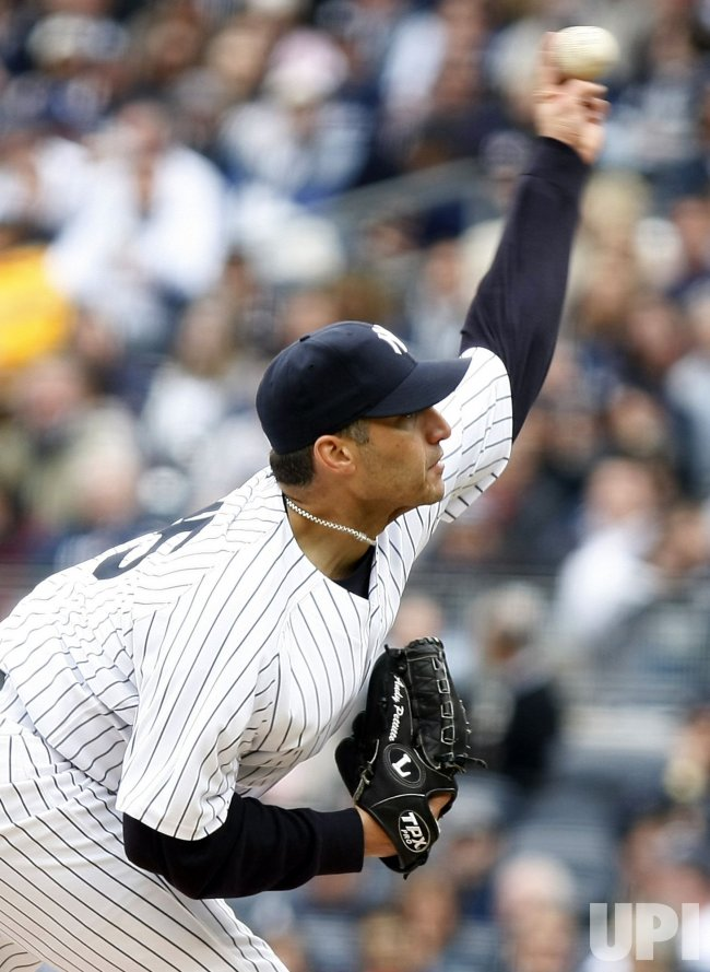 New York Yankees starting pitcher Andy Pettitte throws a pitch on opening day at Yankee Stadium in New York