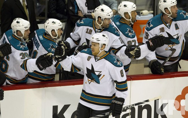 Sharks Pavelski Receives Congratulations from Teammates in Game Six in Denver