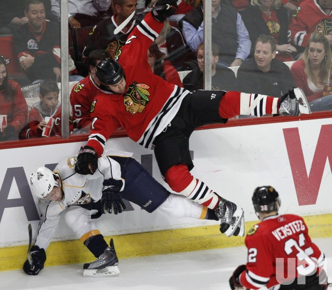 Blackhawks Seabrook and Predators Spaling collide in Chicago