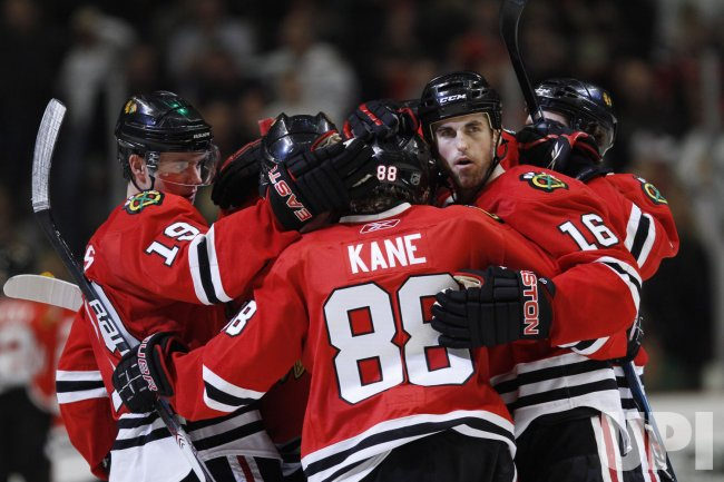 Blackhawks Toews Kane Ladd celebrate win over Bruins in Chicago