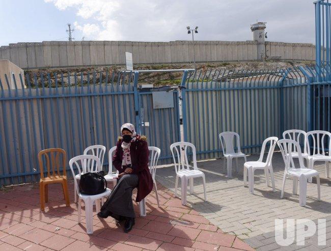 A Palestinian Waits To Receive The Pfizer-Biotech Coronavirus Vaccine At The Qalandiya Checkpoint