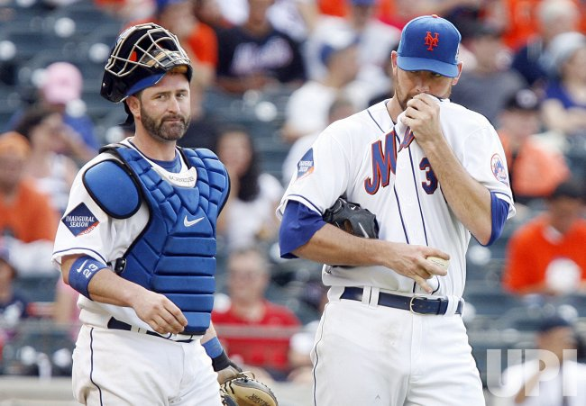 New York Mets starting pitcher Mike Pelfrey and catcher Brian Schneider in the fifth inning against the Arizona Diamondbacks at Citi Field in New York