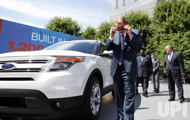 Bill Ford walks up to the 2011 Explorer at unveil in Chicago