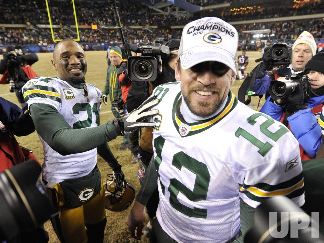 Packers Woodson and Rodgers celebrate after NFC title in Chicago