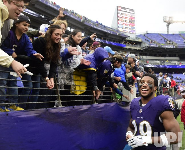 Ravens' Marlon Humphrey celebrates after an NFL game in Baltimore
