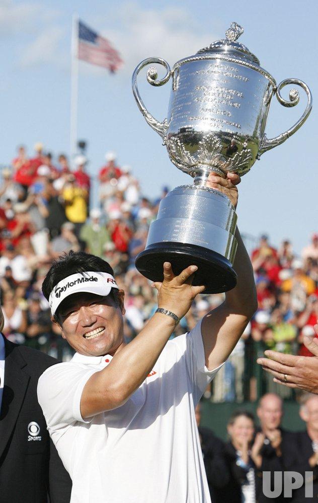 Y. E. Yang of South Korea hoists the Rodman Wanamaker Trophy after winning the 91st PGA Championship in Chaska, Minnesota