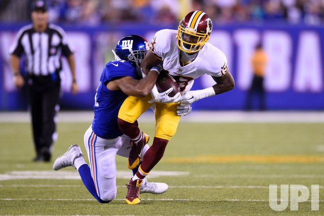 Nike NFL Youth Jerseys - Washington Redskins wide receiver Rashad Ross gets tackled by New ...