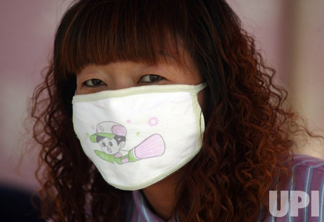Chinese woman wears face mask in Beijing