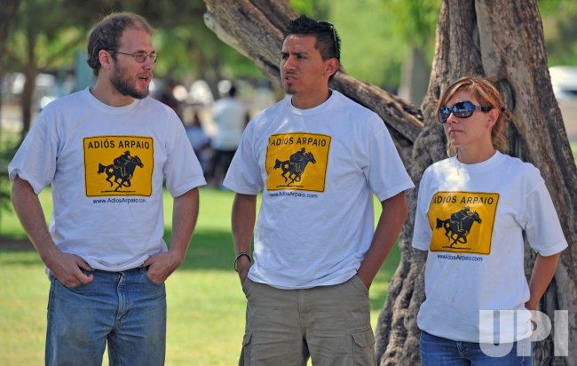 People wear anti Arpaio shirts at deomonstrations on SB1070 in Arizona