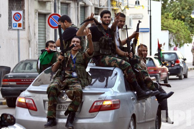 Libyan National Transitional Council (NTC) Fighters Celebrate in the Streets of Tripoli