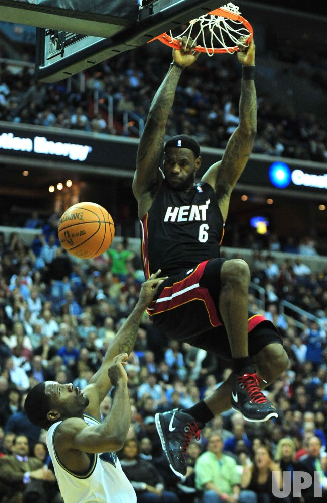 Miami Heat's LeBron James dunks in Washington