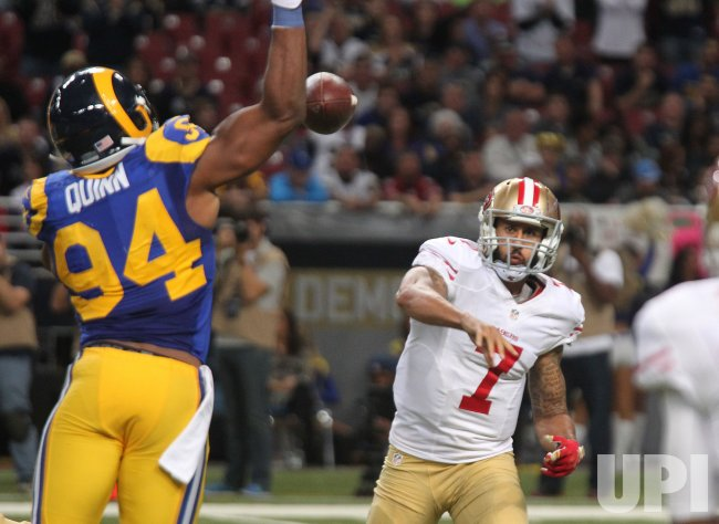 St. Louis Rams Robert Quinn knocks down pass