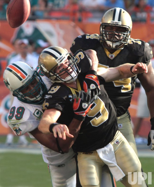 Jason Taylor sacks Drew Brees New Orleans Saints at Miami Dolphins at Landshark Stadium in Miami.