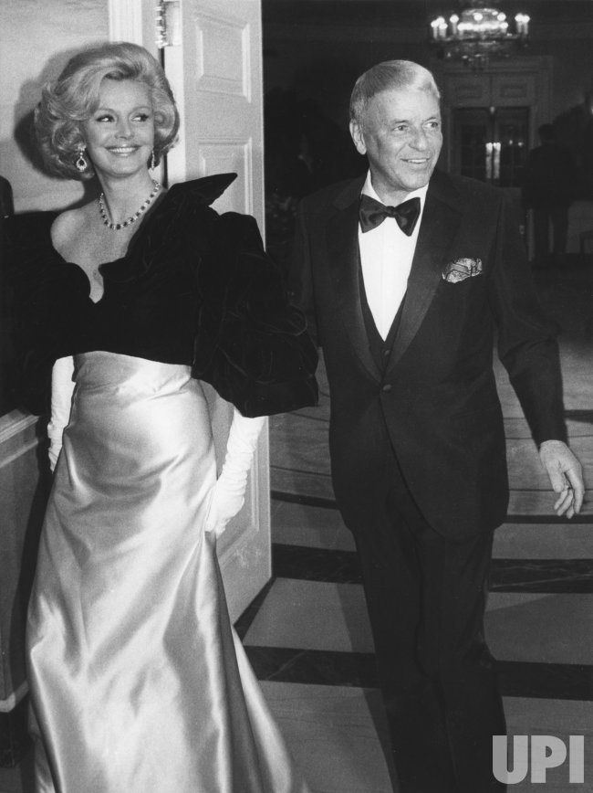 Frank Sinatra and his wife, Barbara arrive at White House to attend Ronald Reagan's 70th birthday party