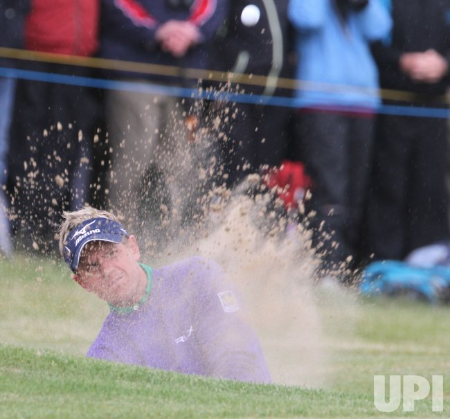 Luke Donald hits out of the bunker during the Open Championship in England