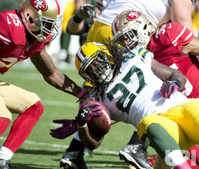 Packers Eddie Lacy plows into San Francisco 49ers