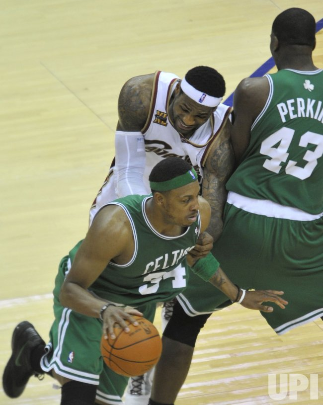 Cavaliers James collides with Perkins of the Celtics