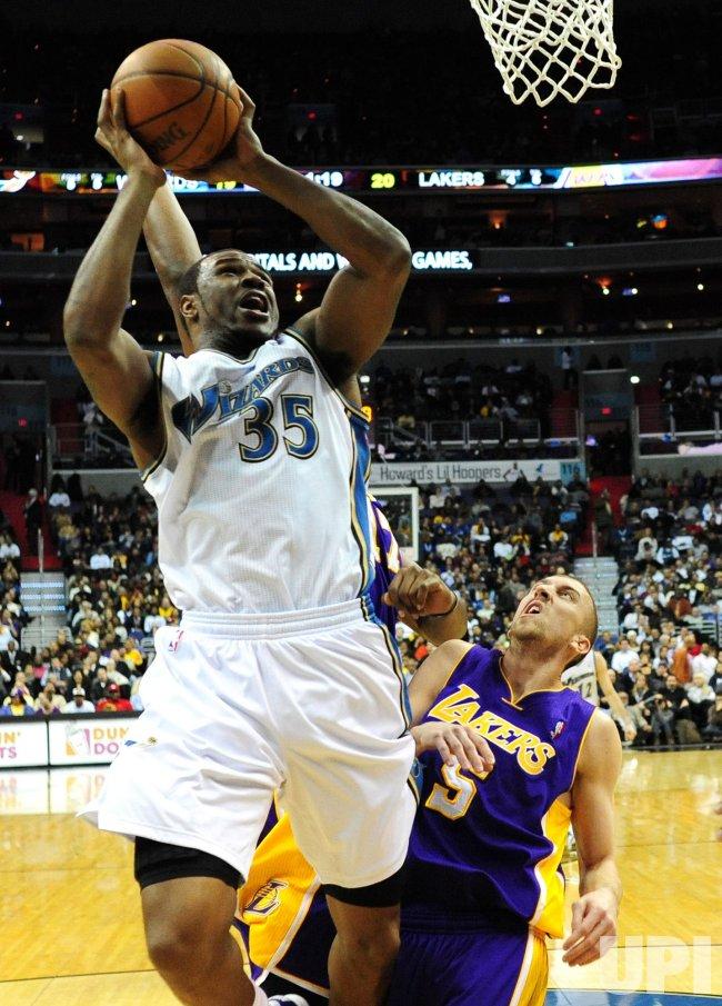 Wizards' Trevor Brooker shoots over Lakers Steve Blake in Washington