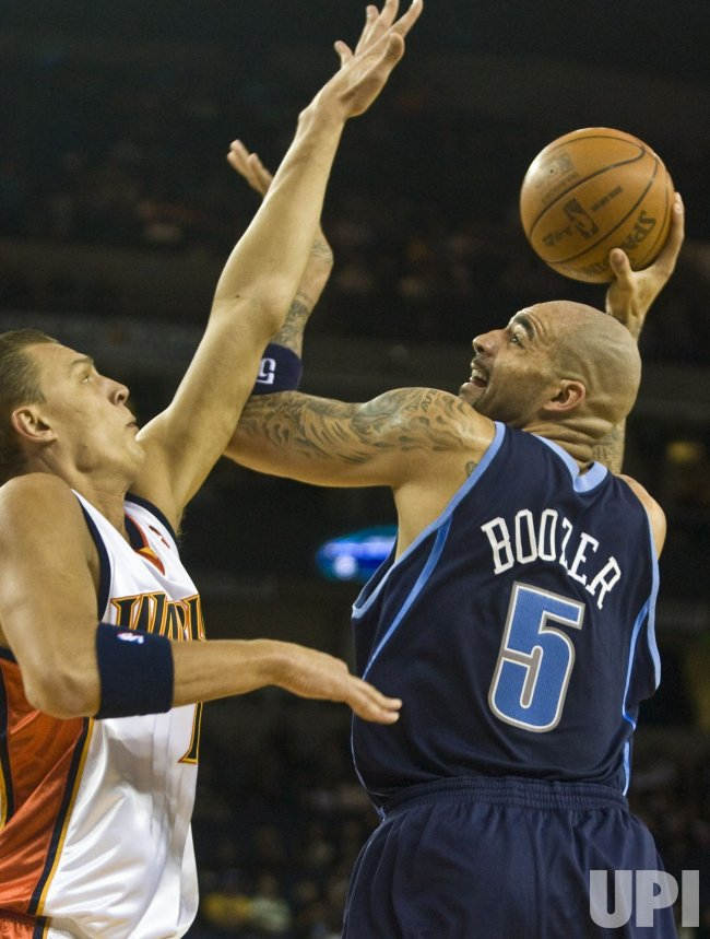 Utah Jazz Carlos Boozer puts up a shot against the Golden State Warriors in Oakland, California