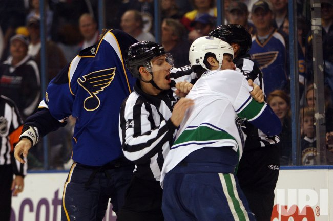St. Louis Blues B.J. Crombeen and Vancouver Canucks Kevin Bieksa fight