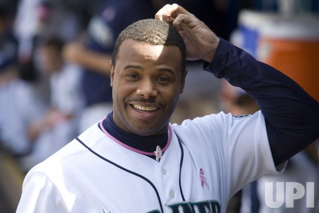 Seattle Mariners' Ken Griffey, Jr., smiles s he scratches his head.