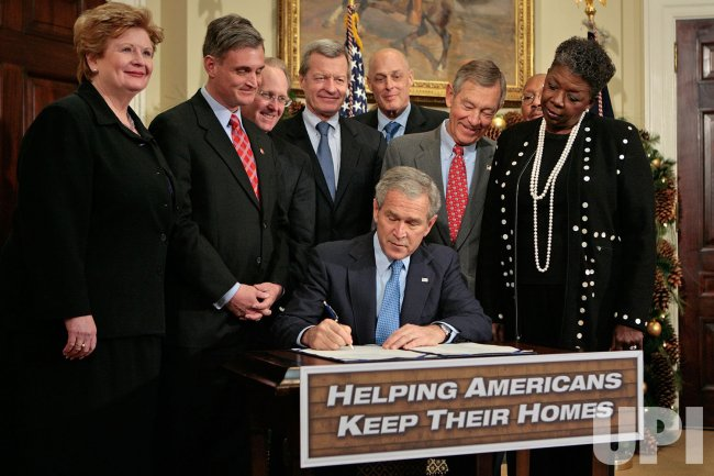 Bush signs the Mortgage Forgiveness Debt Relief Act of 2007 in Washington