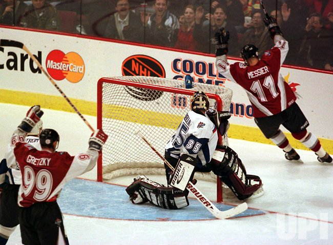 Mark Messier of the North American All-Stars scores the winning against goalie Nikolai Khabibulin