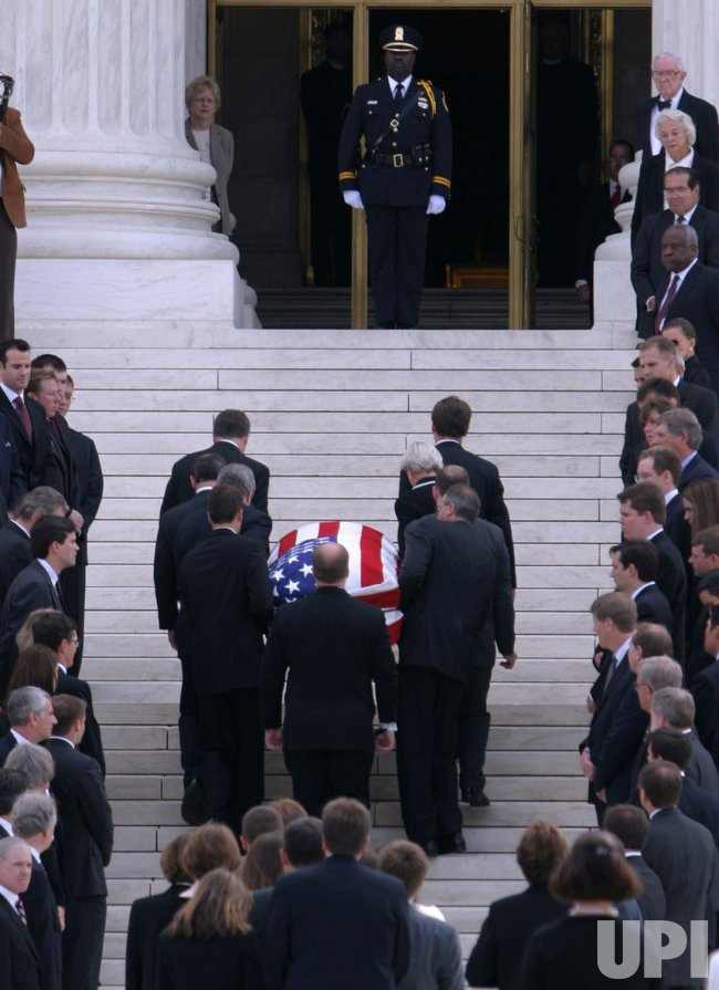 WILLIAM H. REHNQUIST'S CASKET IS MOVED INTO THE SUPREAM COURT