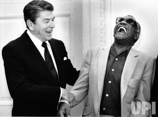 President Ronald Reagan jokes with singer-pianist Ray Charles in the Oval Office