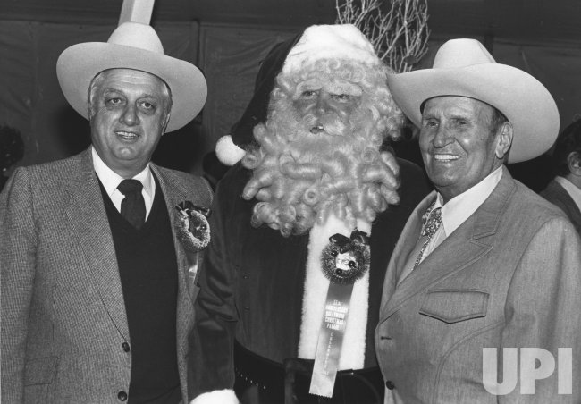 Tommy Lasorda poses with Gene Autry and Santa
