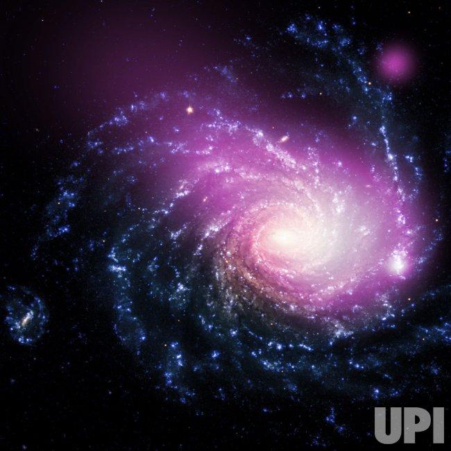 Dwarf Galaxy Caught Ramming Into a Large Spiral Galaxy.