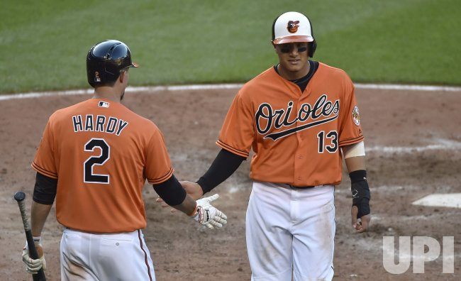 Baltimore's Manny Machado scores the winning run against the Los Angeles Angels