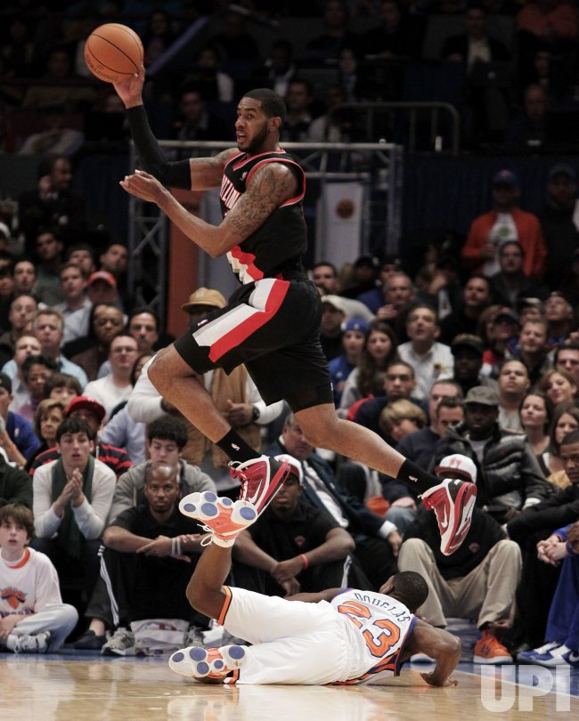 Portland Trailblazers LaMarcus Aldridge leaps over New York Knicks Toney Douglas at Madison Square Garden in New York