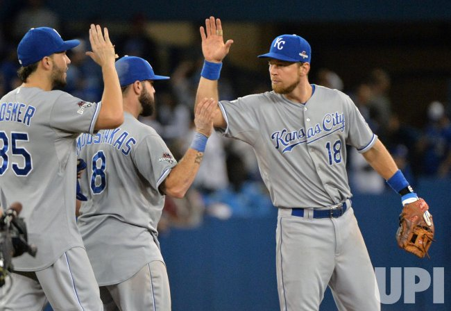 Royals Hosmer, Bautista, and Zobrist high five after win