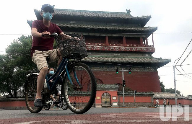 Chinese Cycle Through A Historic Area in Beijing, China