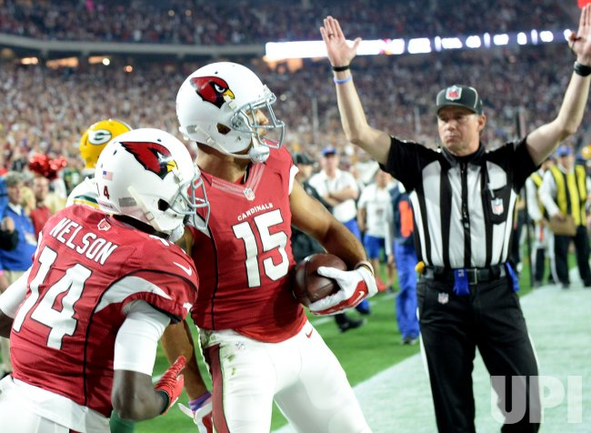 Cardinals Floyd and Nelson celebrate Floyd's touchdown