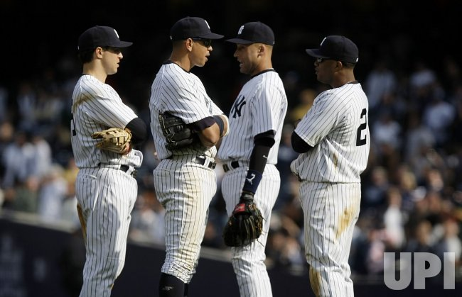 New York Yankees Mark Teixiera, Alex Rodriguez, Derek Jeter and Robinson Cano (R) talk on opening day at Yankee Stadium in New York
