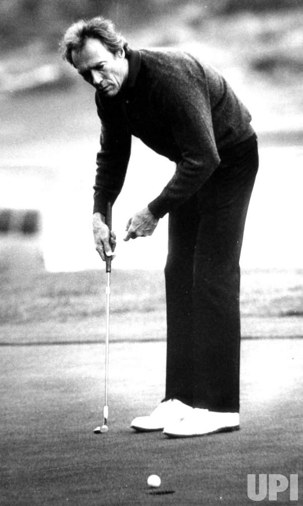CLINT EASTWOOD PLAYING GOLF